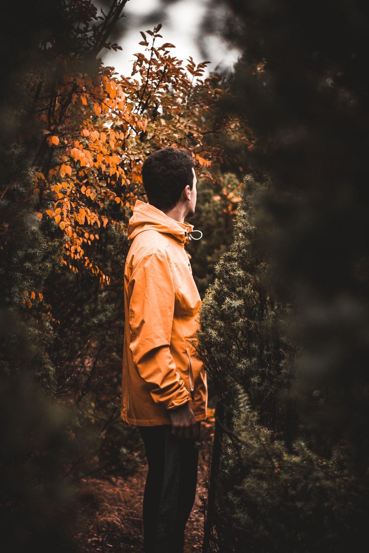 man in an orange hoodie jacket