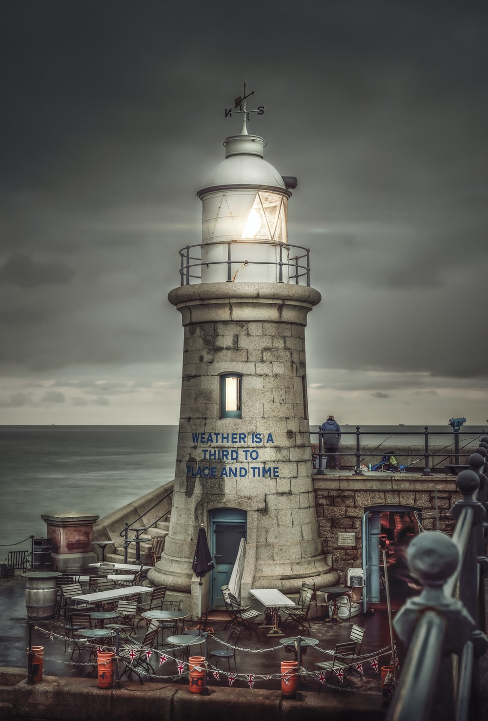 white and black lighthouse viewing sea