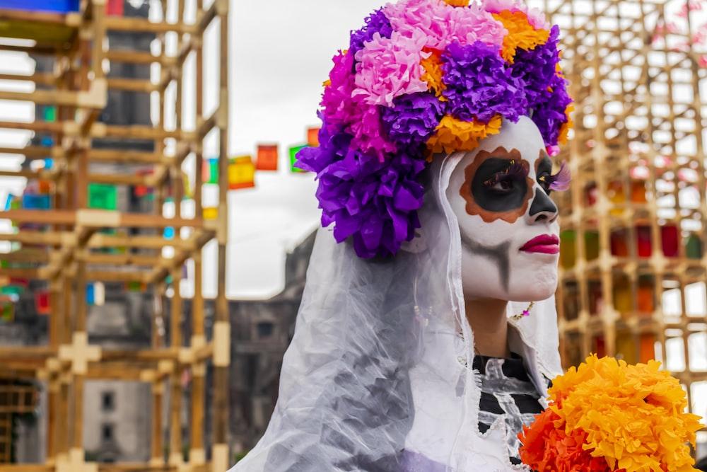 person wearing flowers near scaffolding