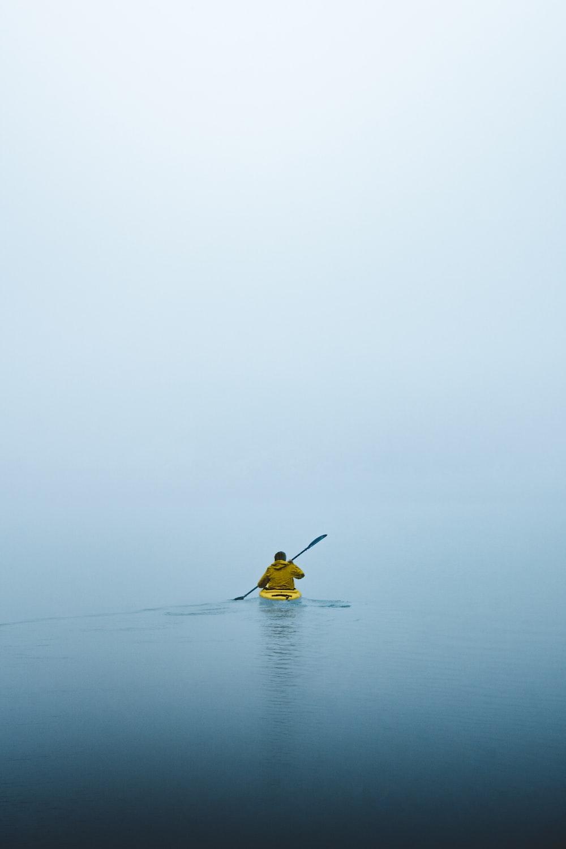 man on kayak during daytime