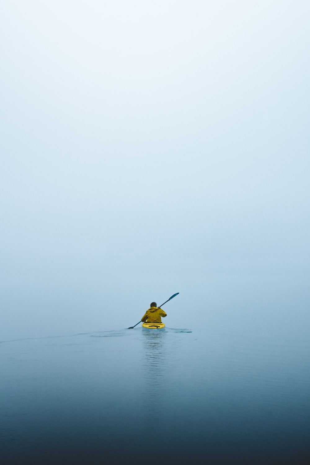 man on kayak during daytime