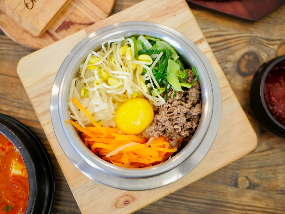 sliced vegetables in gray bowl