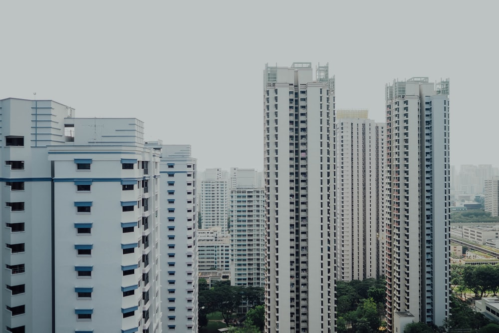 high-angle photography of white high-rise buildings