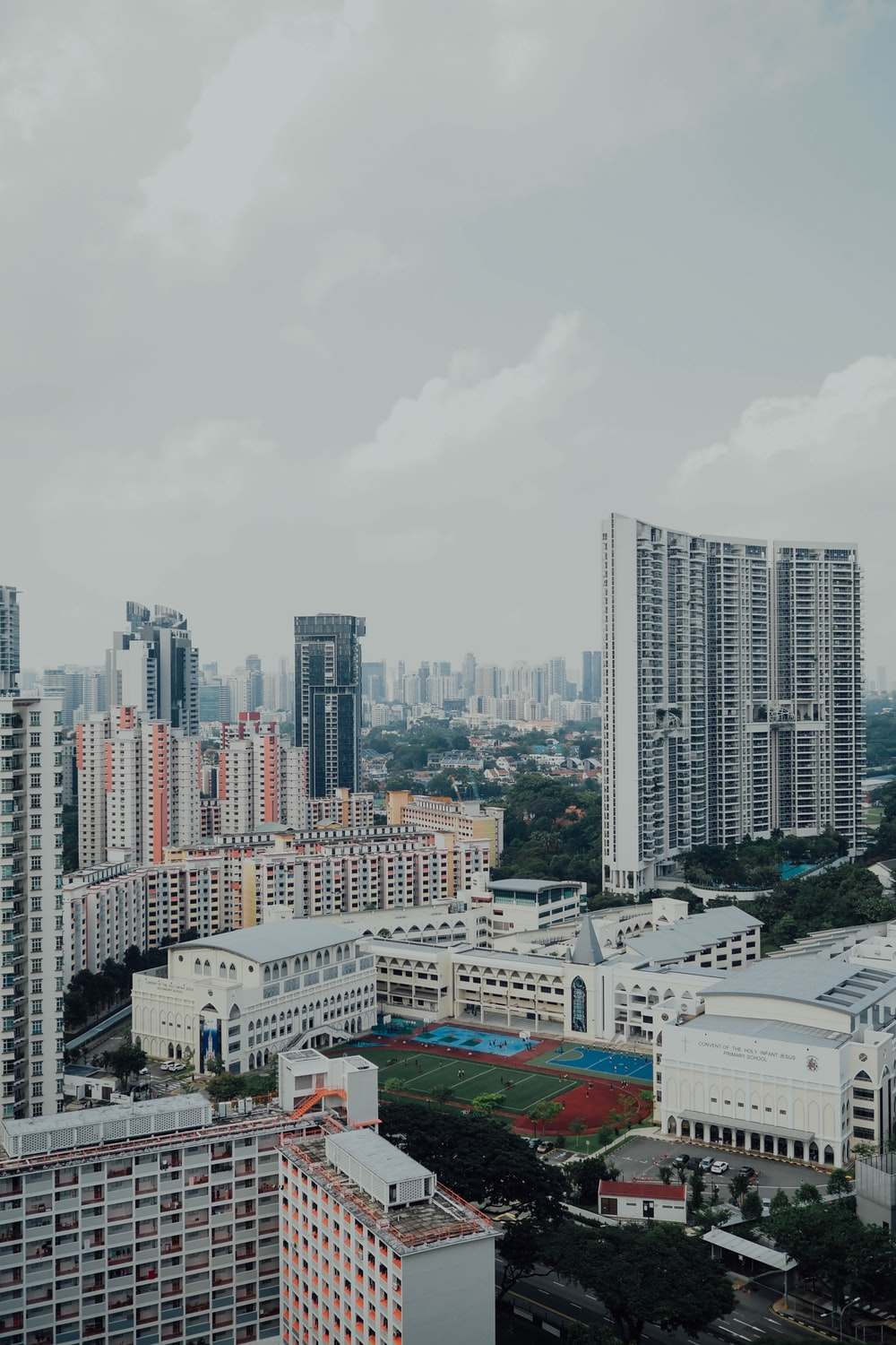 high-rise buildings under white sky