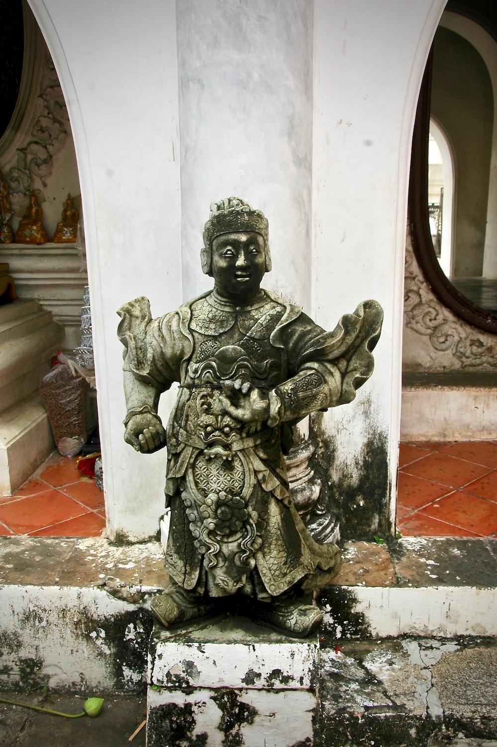man wearing royal suit statue