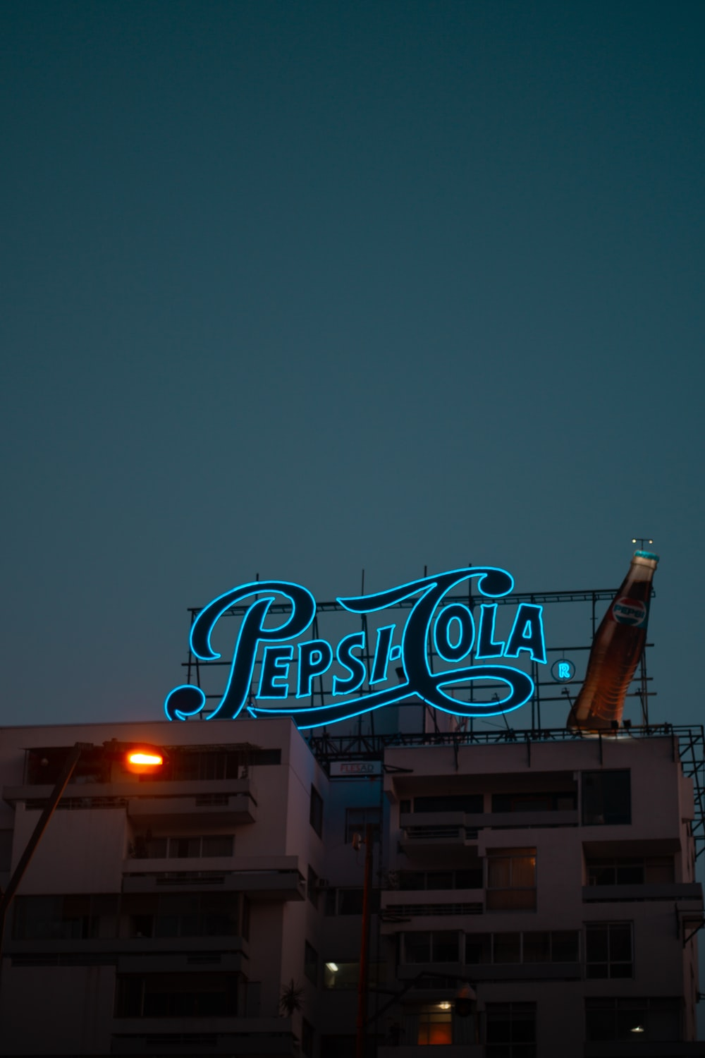 blue and black Pepsi Cola neonlight on top of building