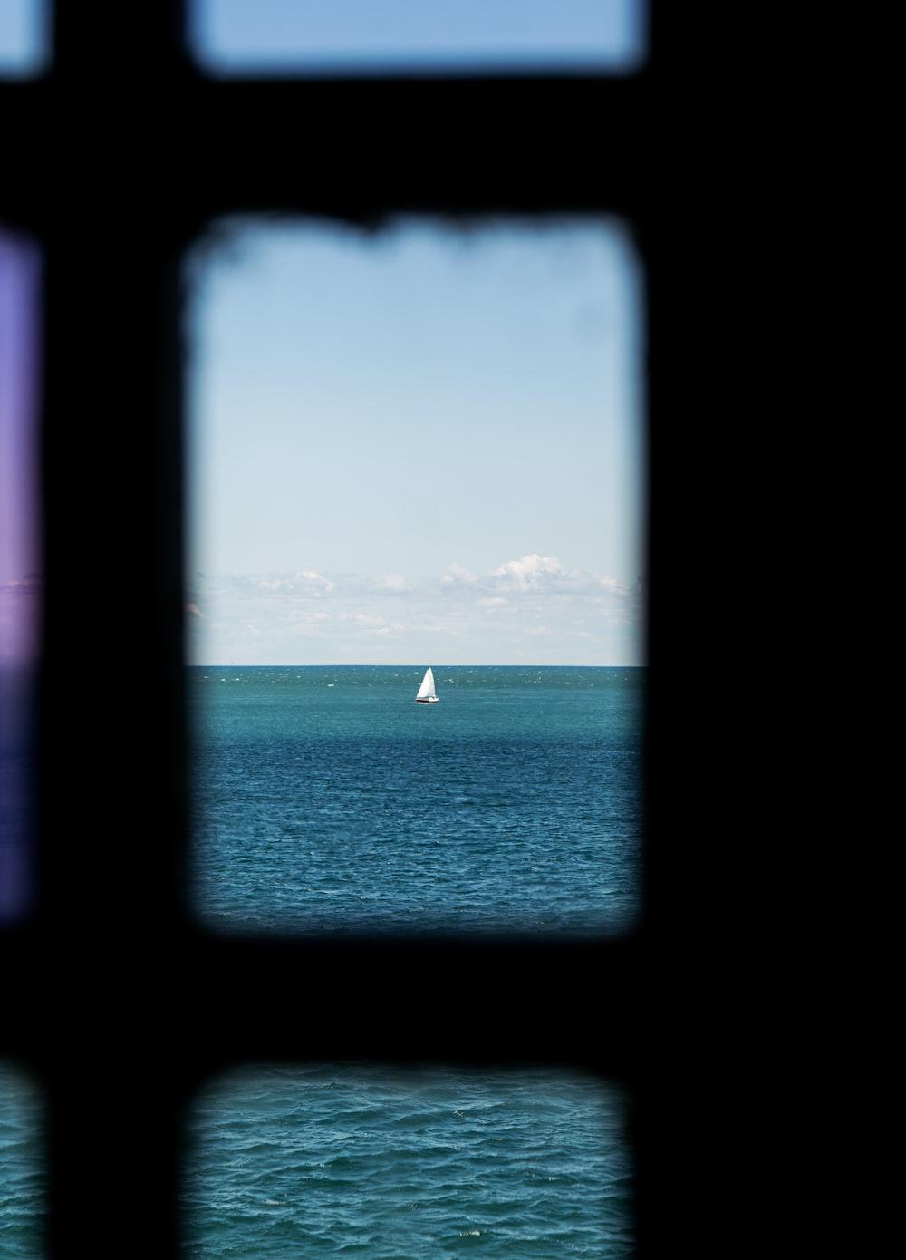 white sailboat on sea