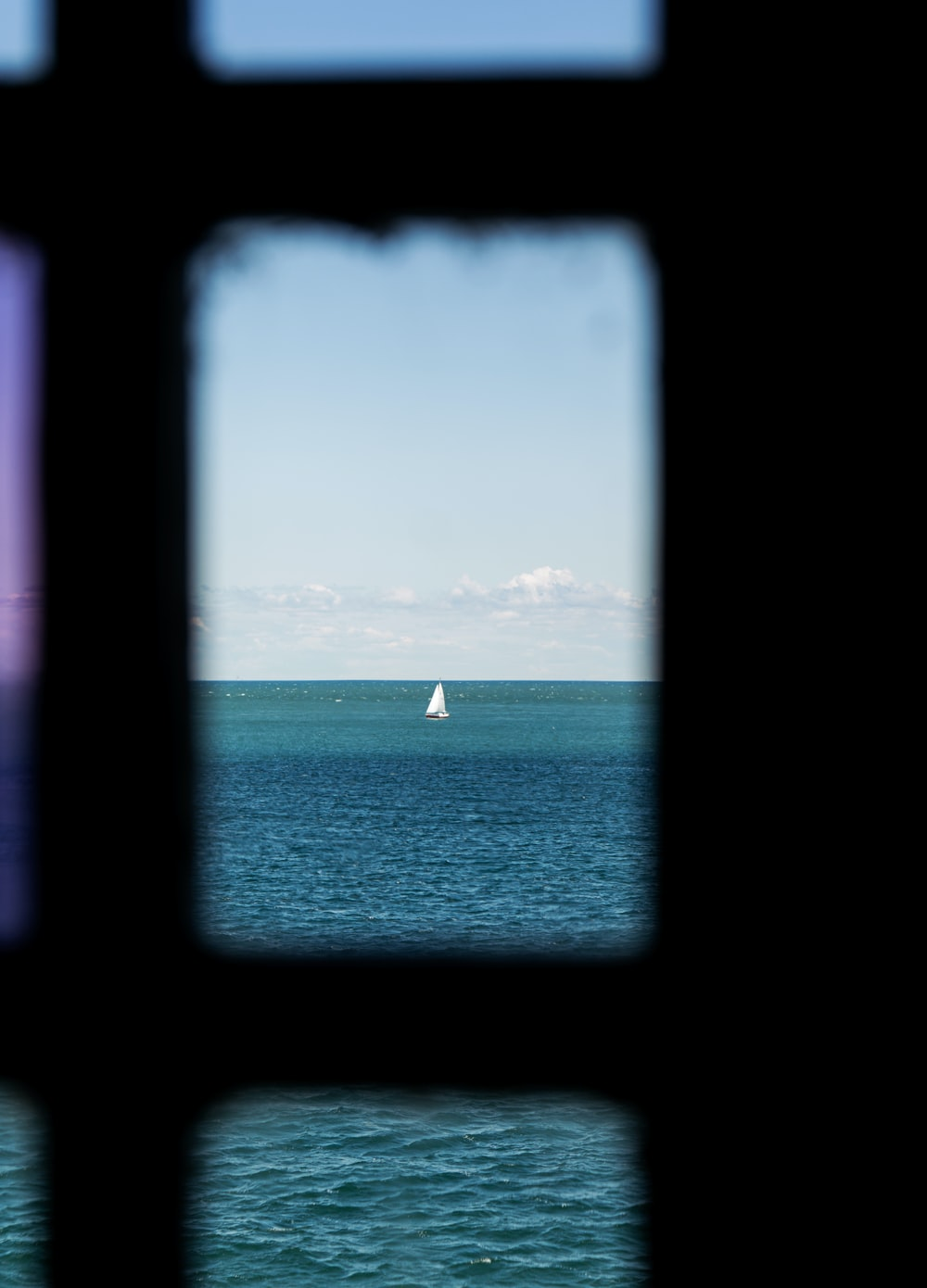 white sailboat on sea