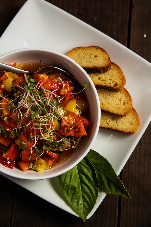 tomato dish and bread slices