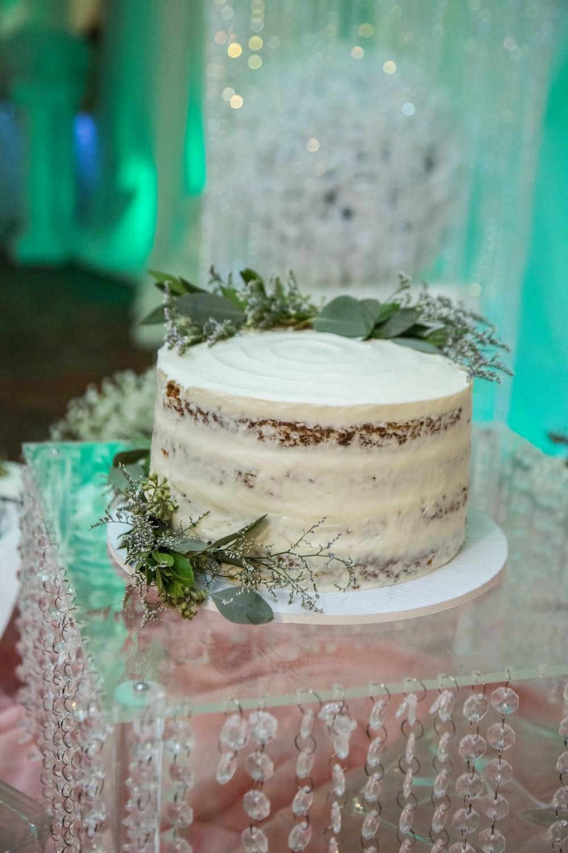vanilla cake on glass stand