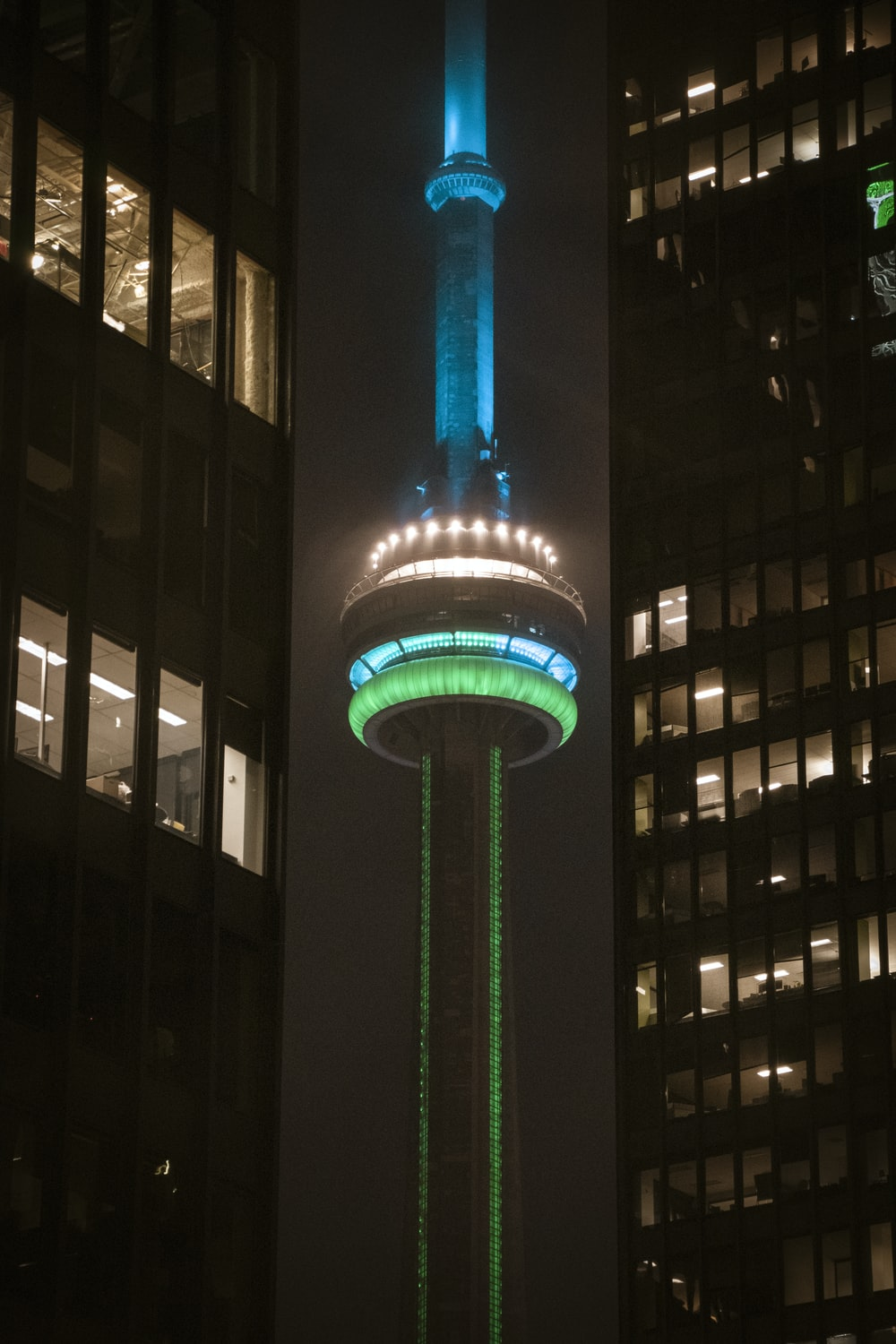lighted blue and green tower during nighttime