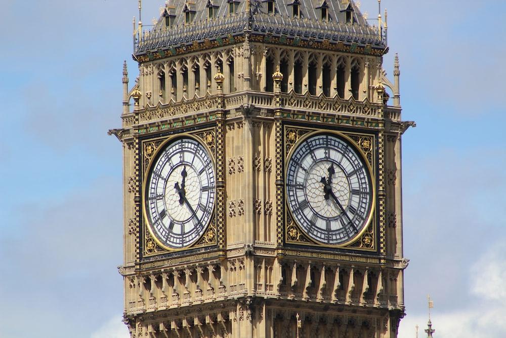 brown concrete clock tower