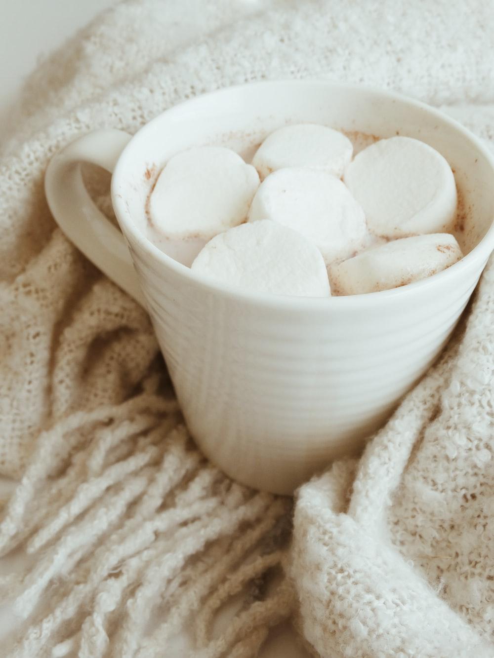 marshmallow in white ceramic mug