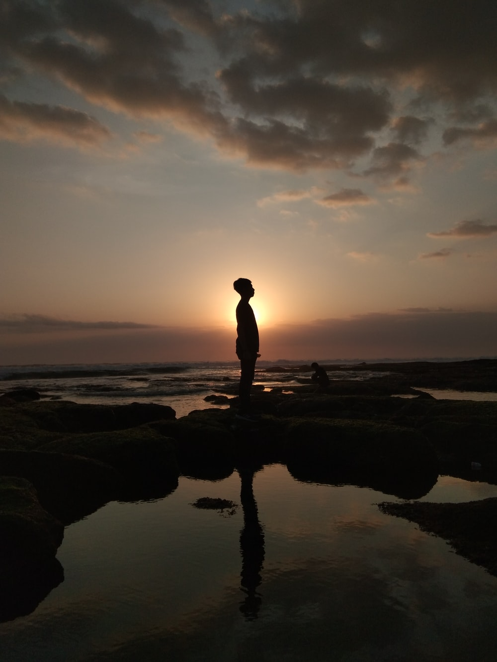 silhouette of person standing while facing left side