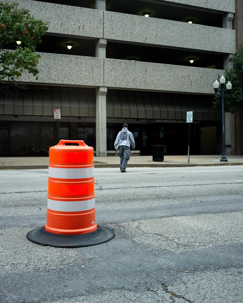 round orange and white striped traffic cone