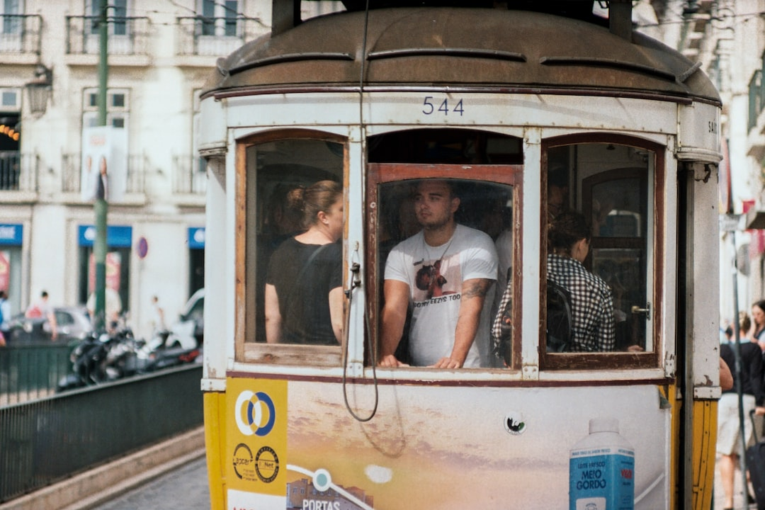 Lisbon vintage tram in city centre with people commuting