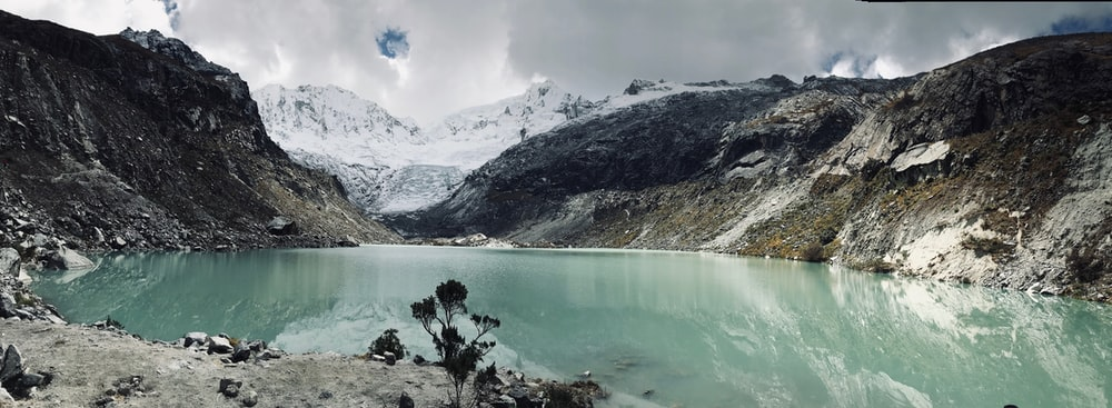blue lake surrounded by mountains
