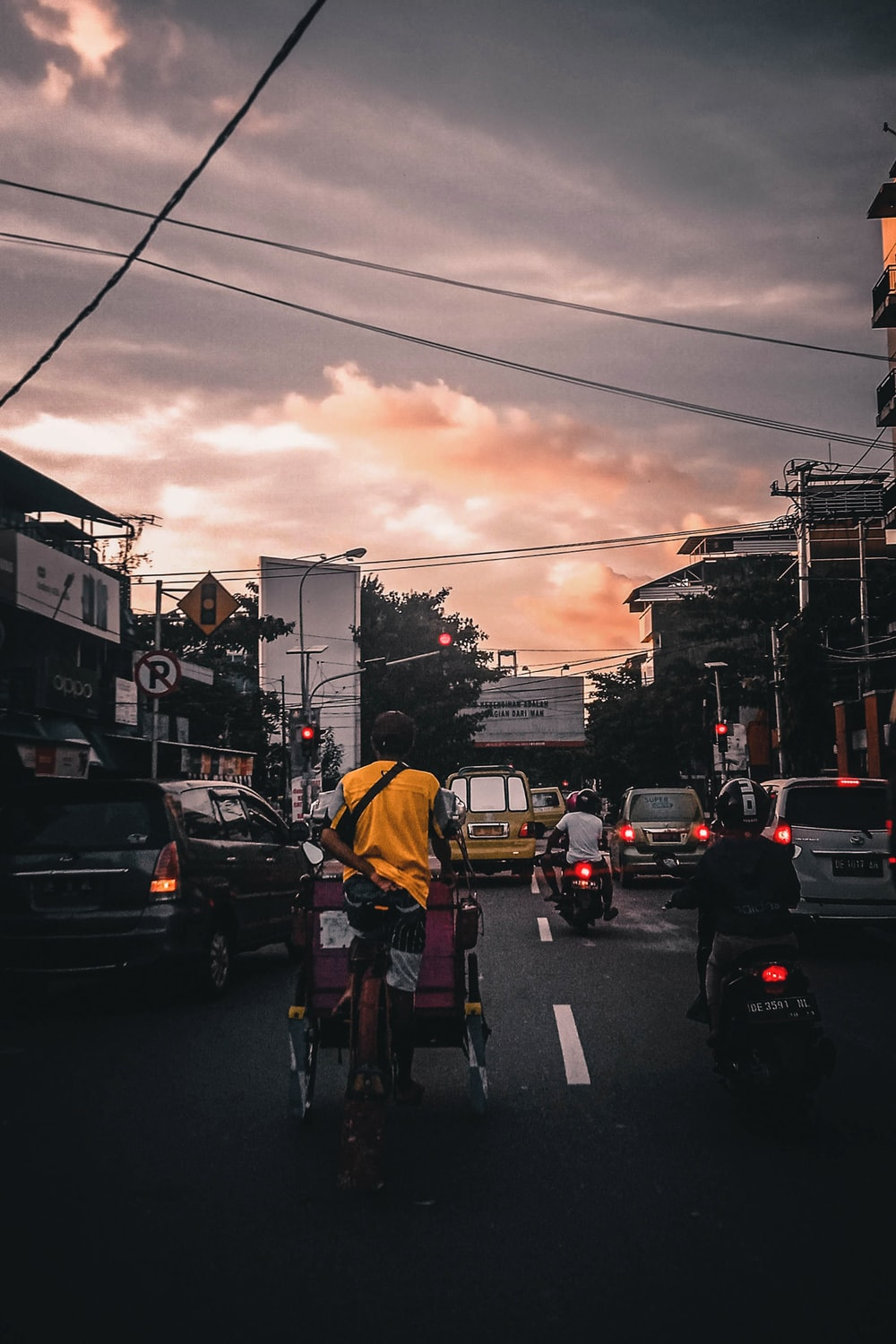 vehicles passing on road during golden hour