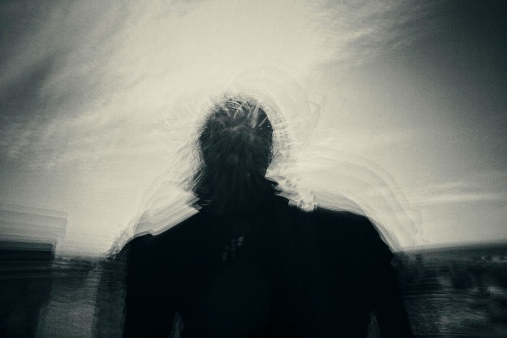 silhouette of person under gray sky