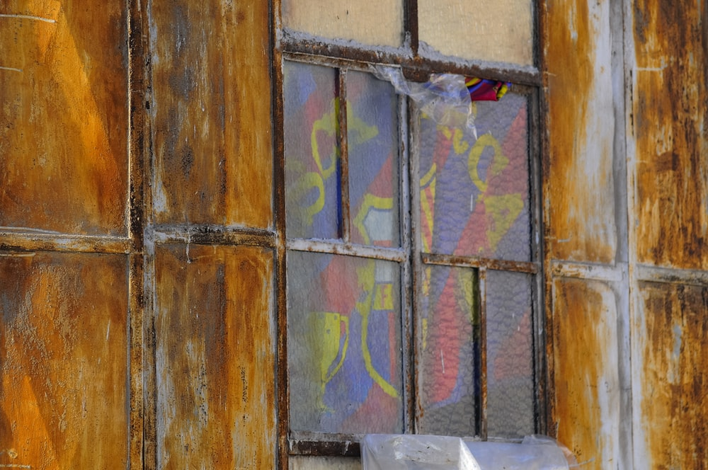 closed window with multicolored curtain
