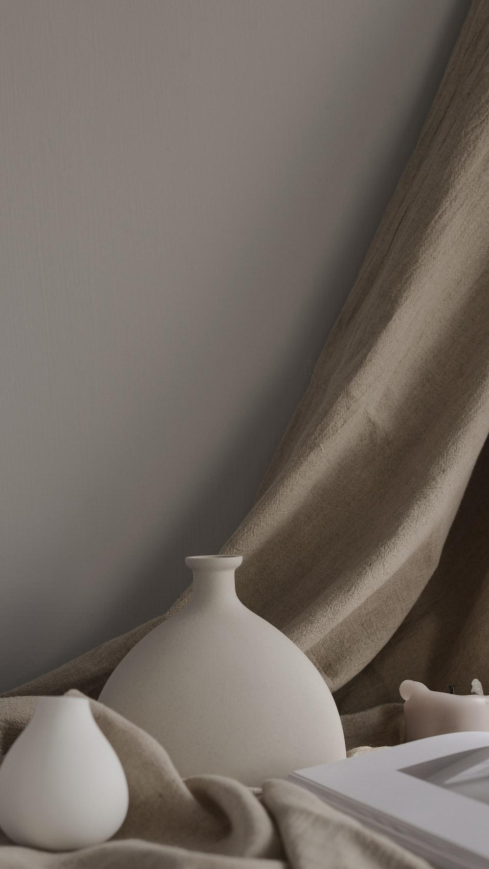 minimalist photography of two white ceramic vases