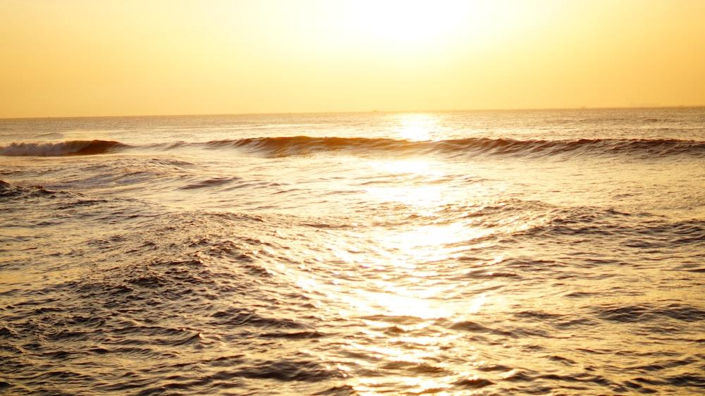 blue sea under yellow sky