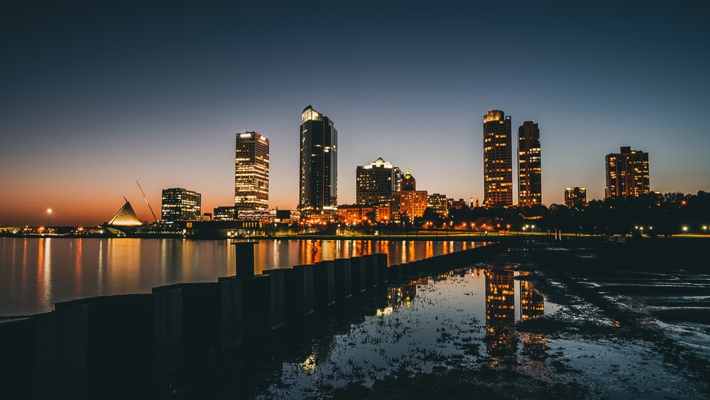 high-rise buildings near calm body of water