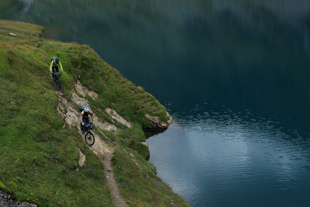 two person riding mountain bike