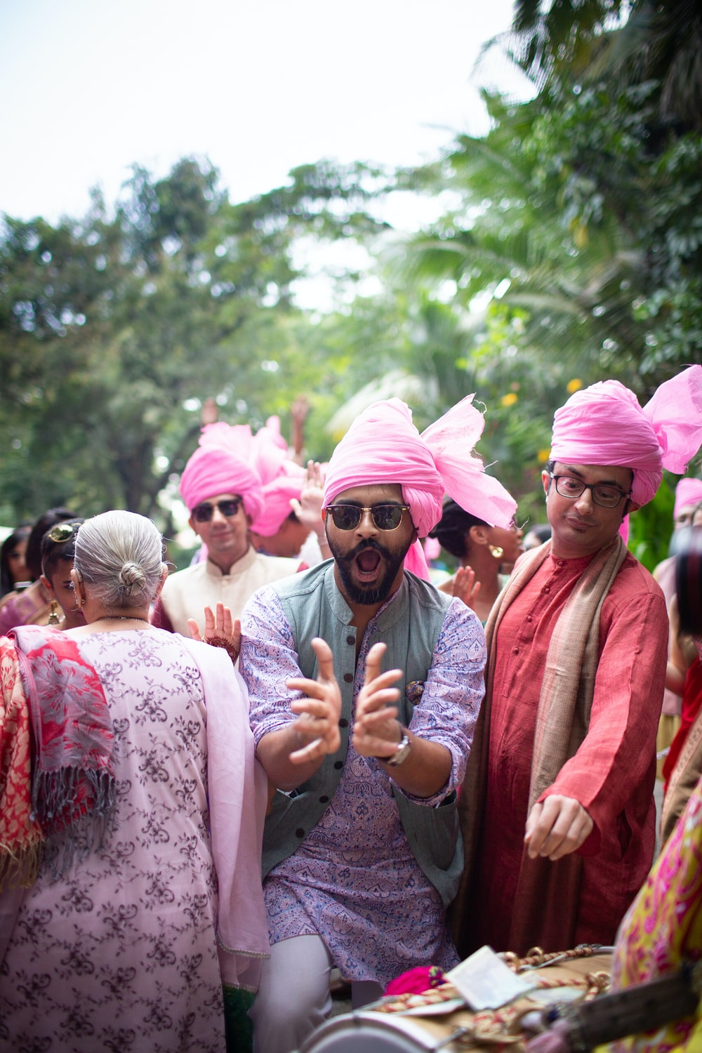 men wearing pink turbans