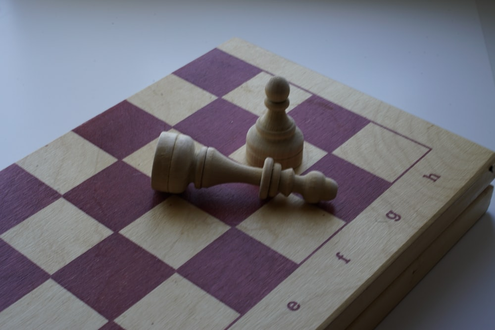 pawns and bishop chesspiece on chessboard
