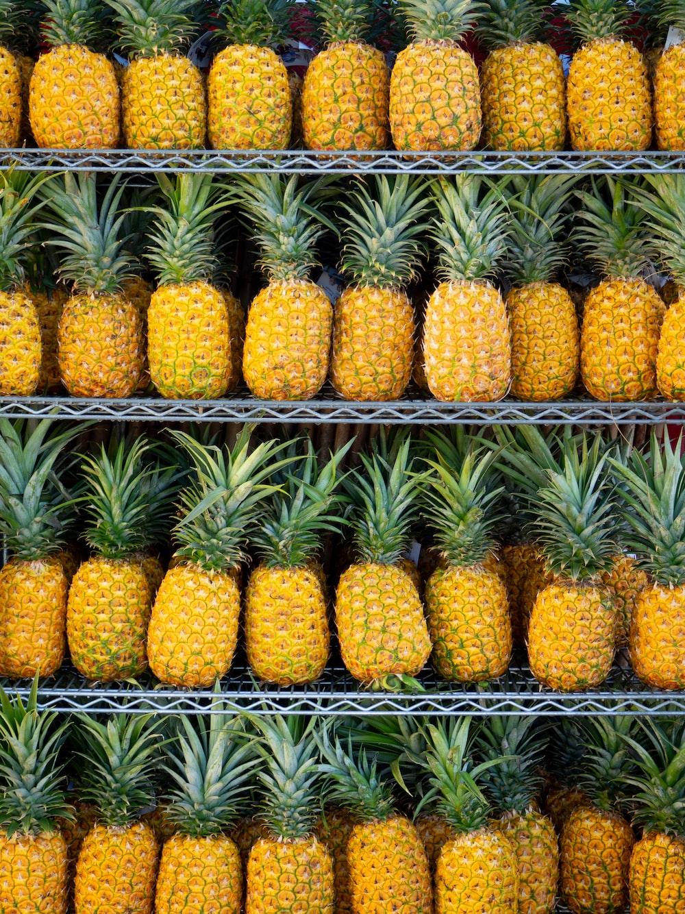 ripe pineapple fruits on shelf