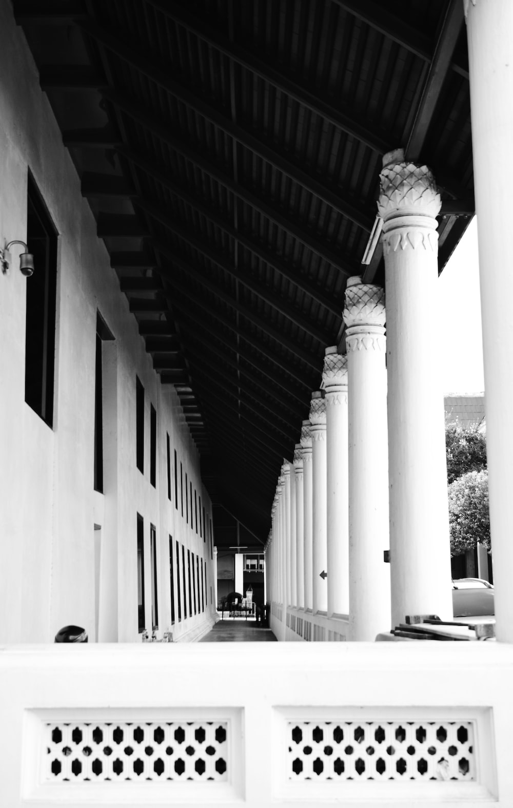 grayscale photography of a building hallway