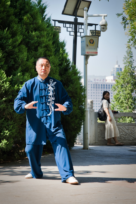 man wearing blue traditional Chinese dress