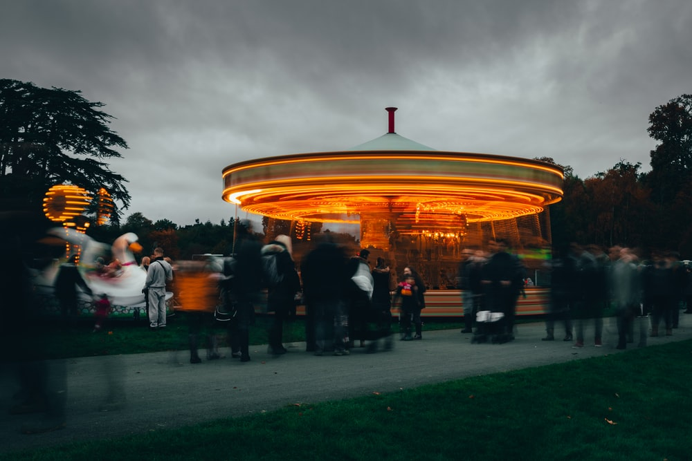 people near horse carousel