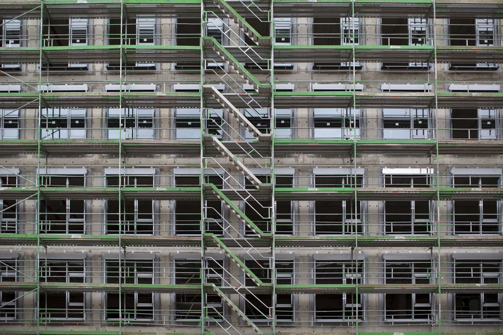 brown and green high-rise building