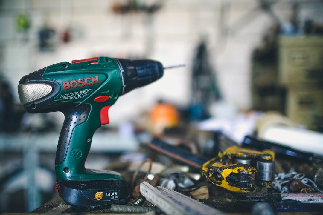 Workshop garage, caftsman & tools cordless screwdriver.