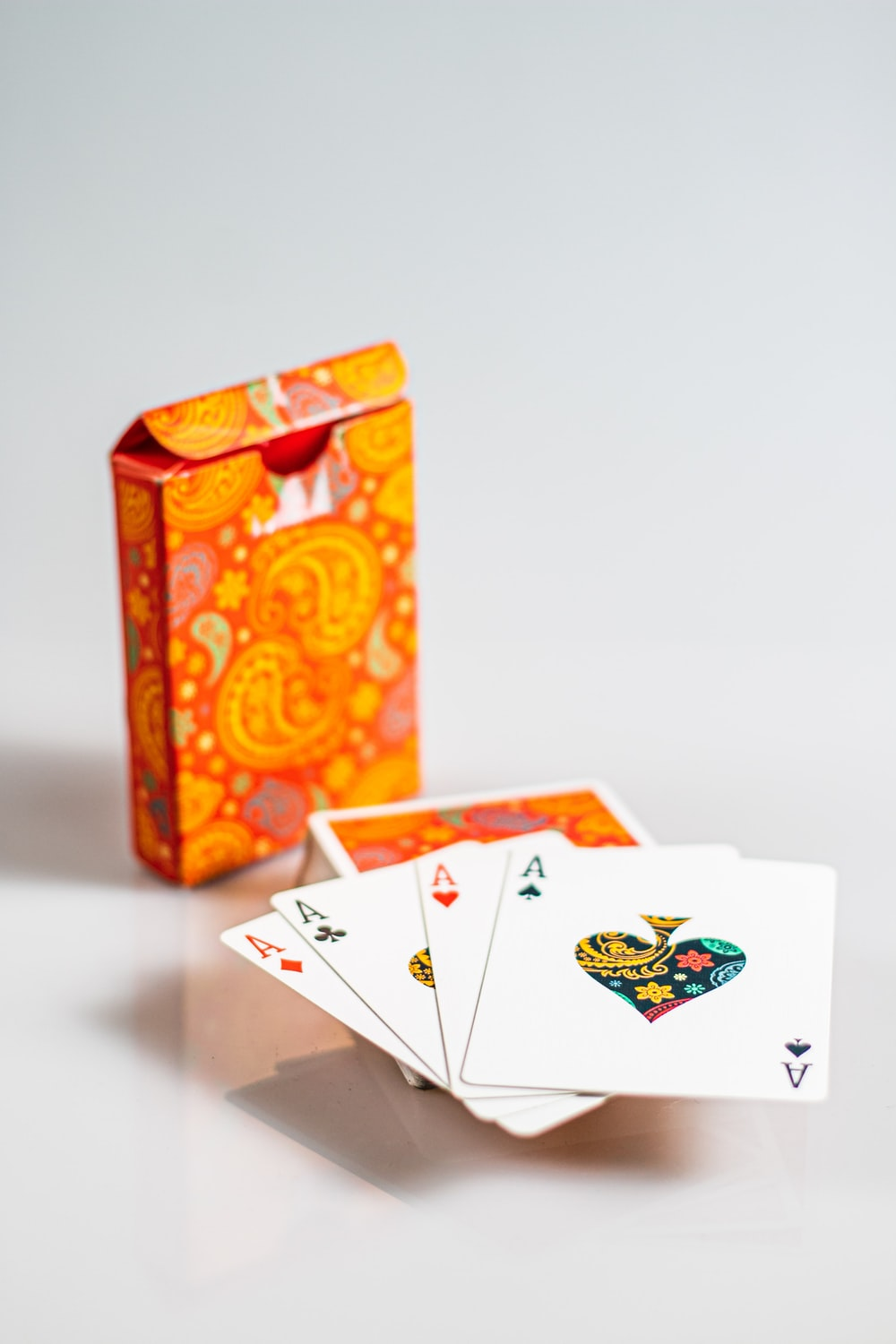 four ace playing cards with box