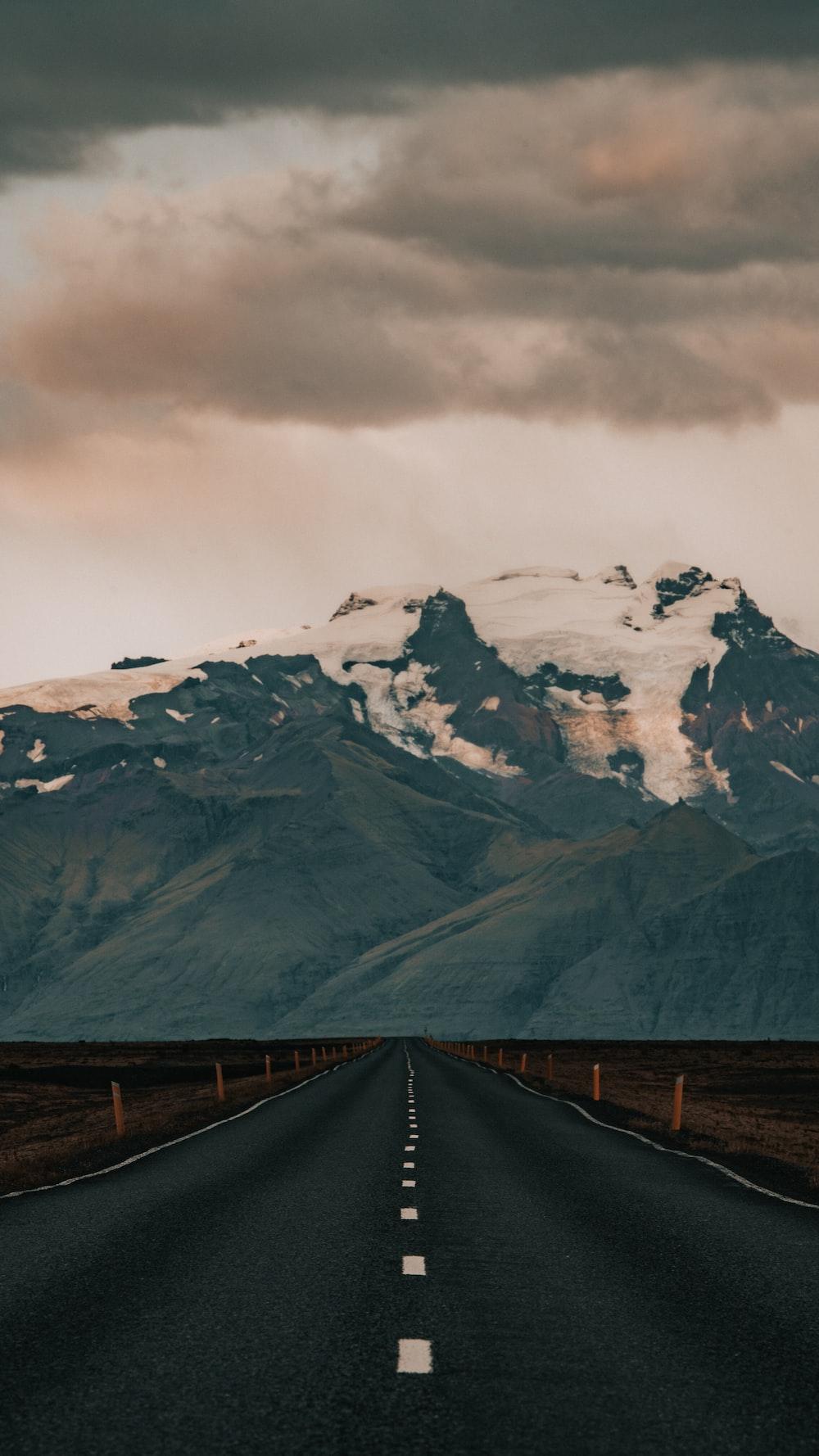 empty road under grey sky