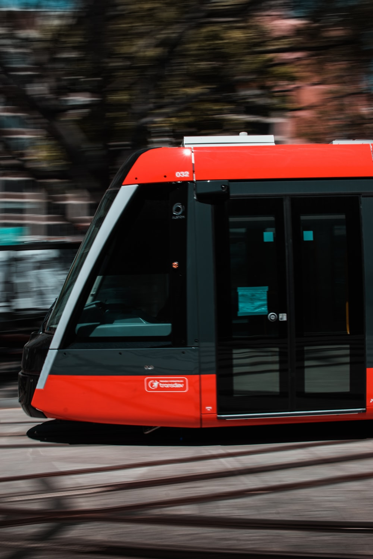 photo of red and grya city train