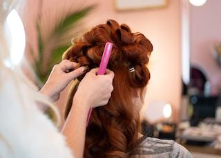 woman fixing woman's hair
