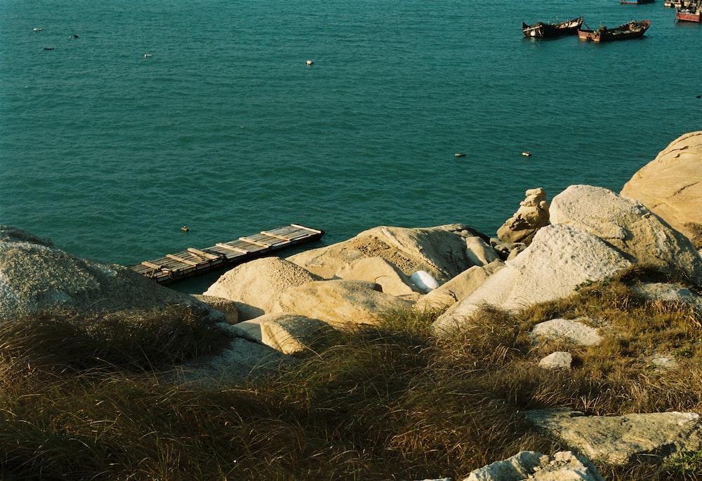 rock near body of water