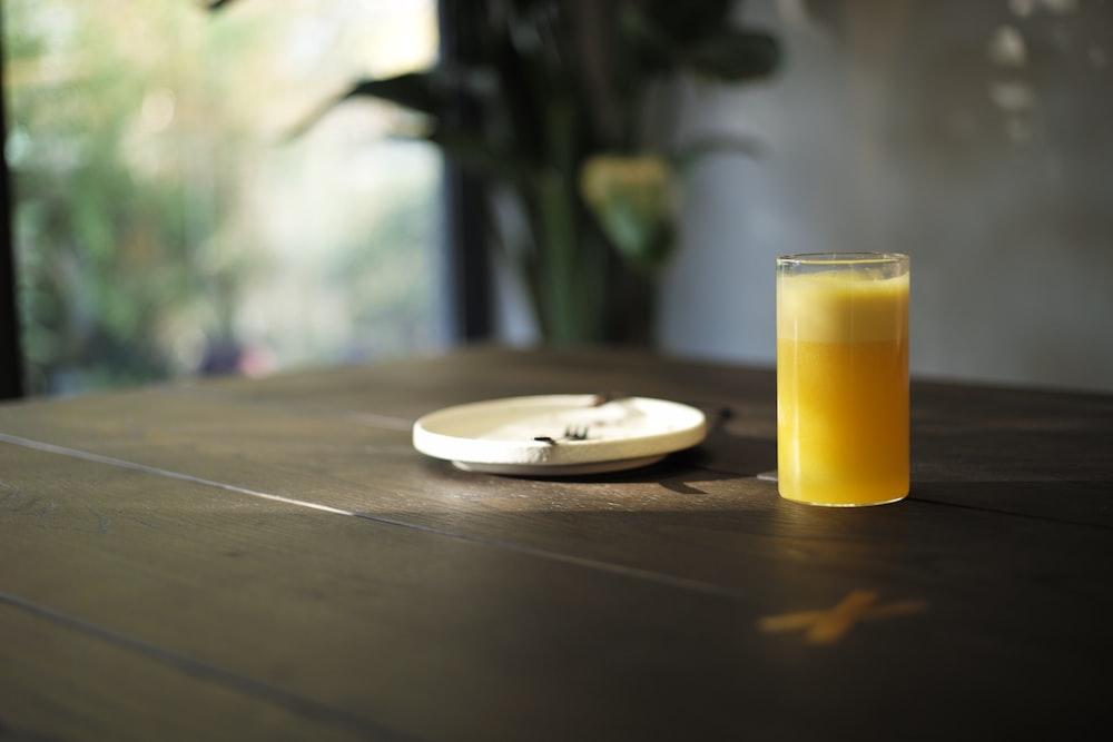 saucer beside glass cup