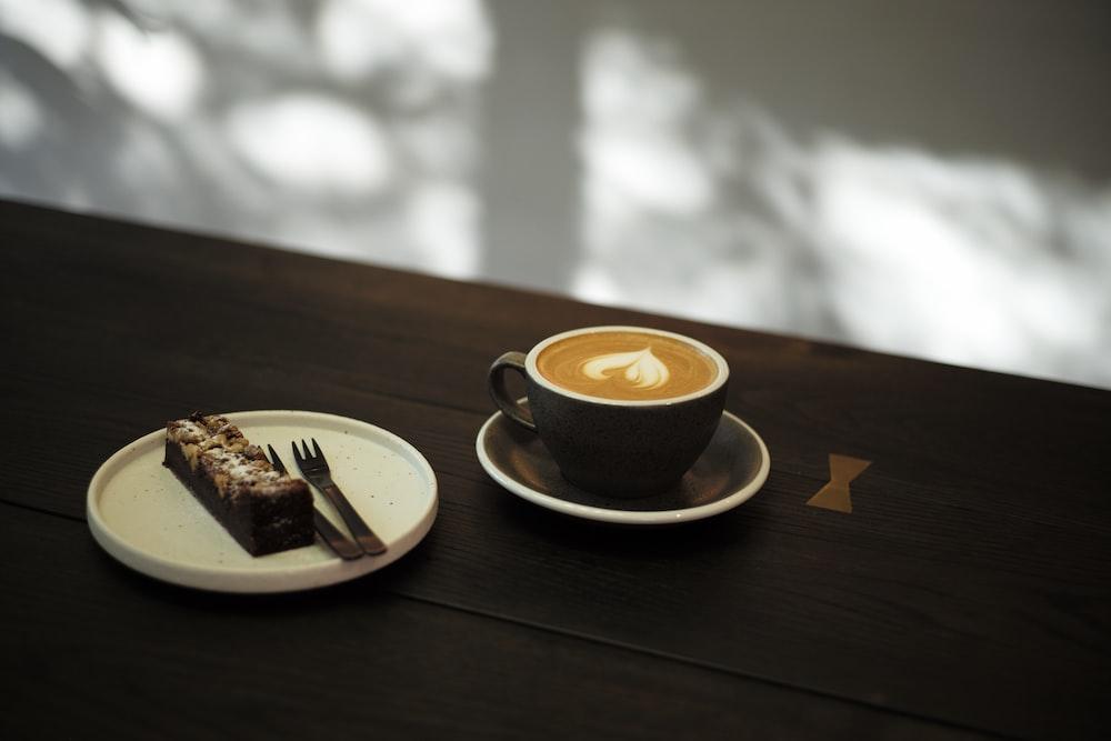 chocolate cake beside latte