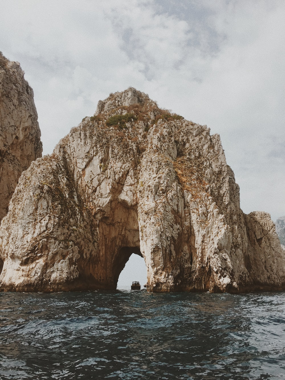 brown arched-shaped cliff