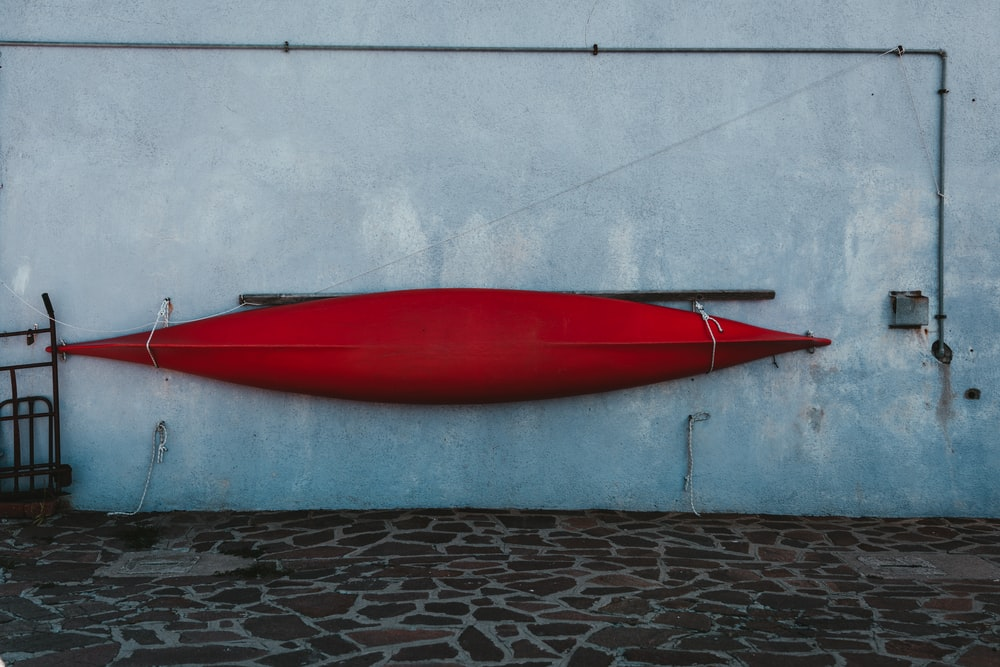 red canoe on wall