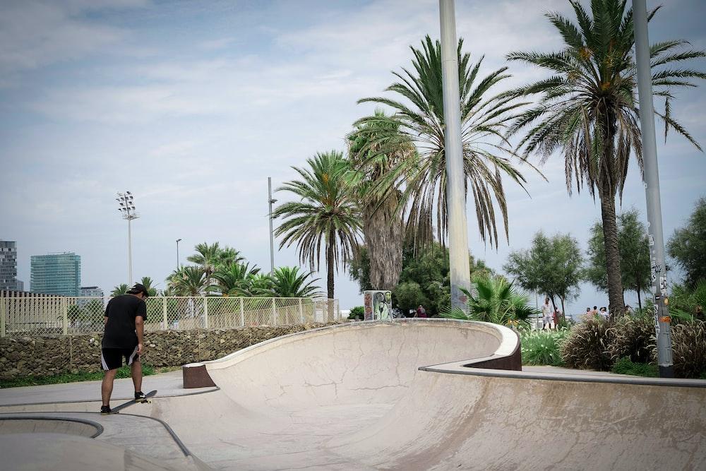 man doing tricks on a skate ramp