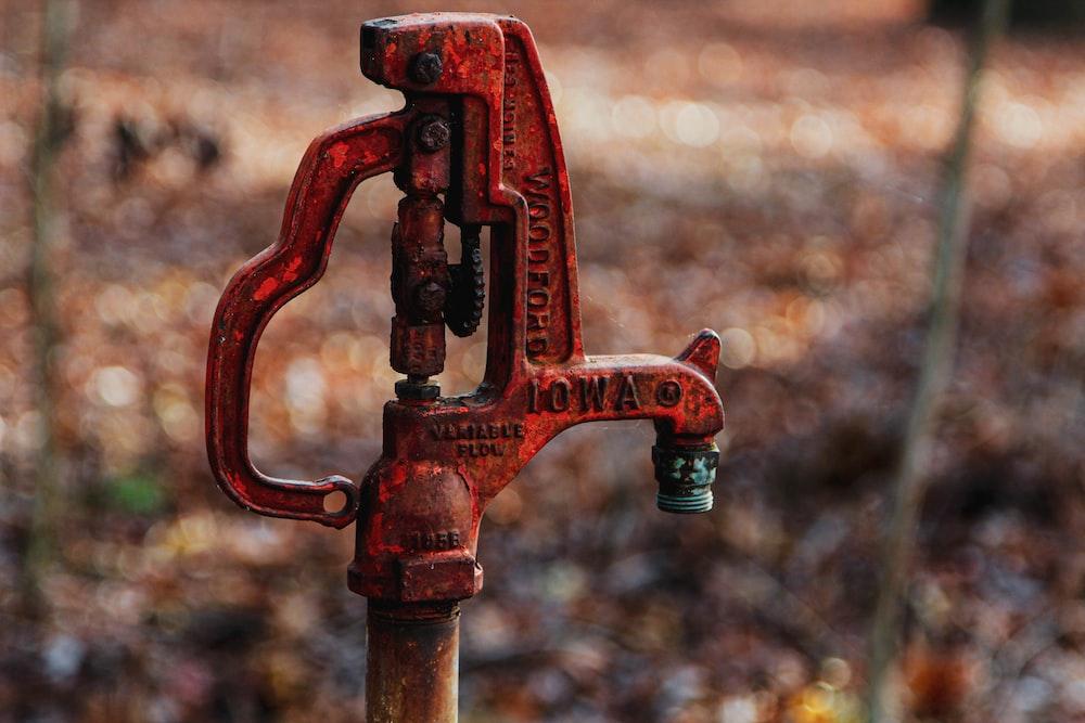 red metal hand pump