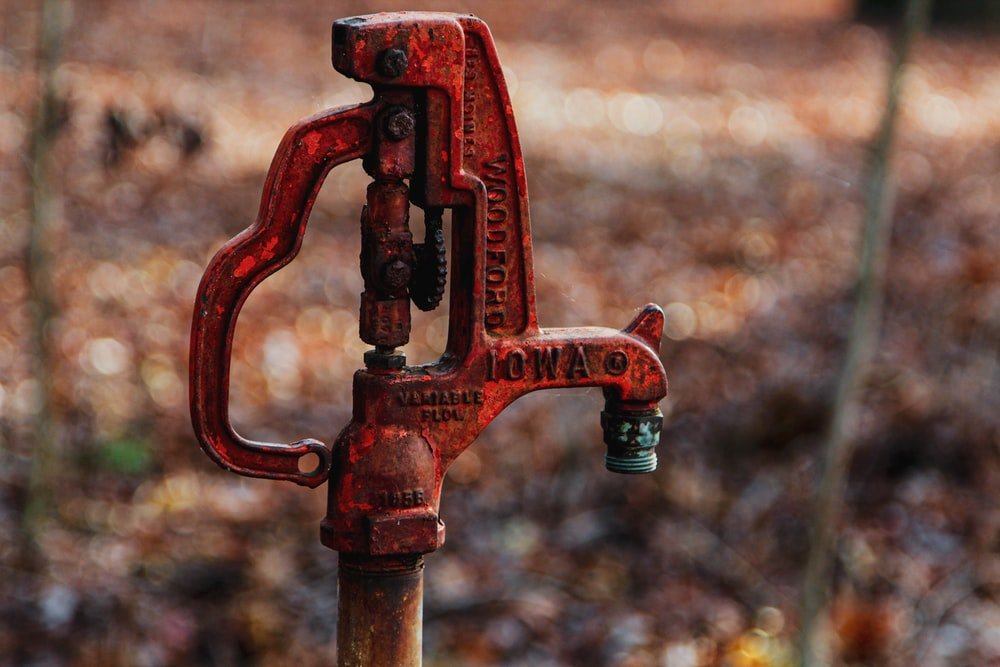 red metal hand pump