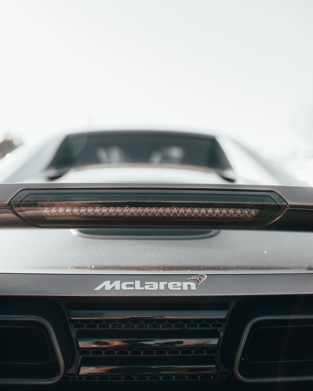 selective focus photography of black Mclaren vehicle