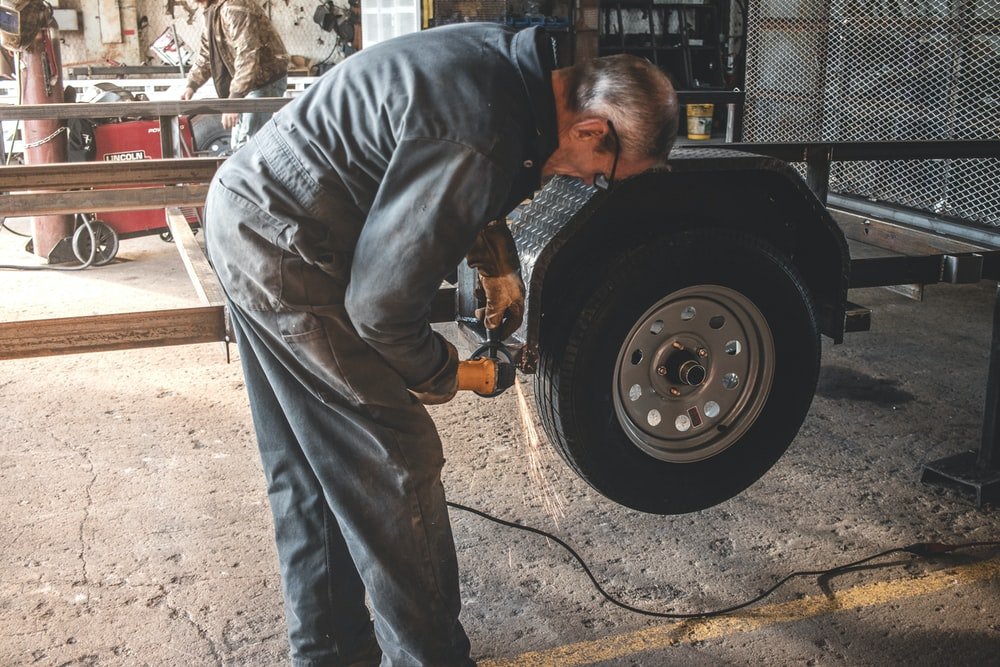 man fixing a vehicle tire